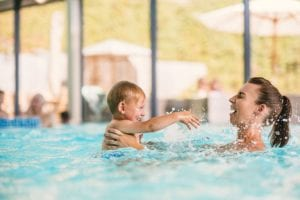 parent and baby swimming